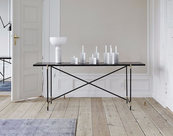 The HANDVÄRK Console // Brass on Black // Black Marble at the HANDVÄRK Showroom in Copenhagen. Styled with Cross Candles designed by Laura Bilde and a lamp from Newworks.