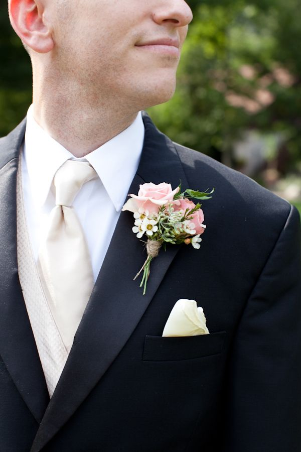 Peach rose boutonniere wrapped in twine. #weddingsuit #boutonniere #buttonhole http://www.weddingchicks.com/2013/10/30/peach-and-cream-garden-wedding/