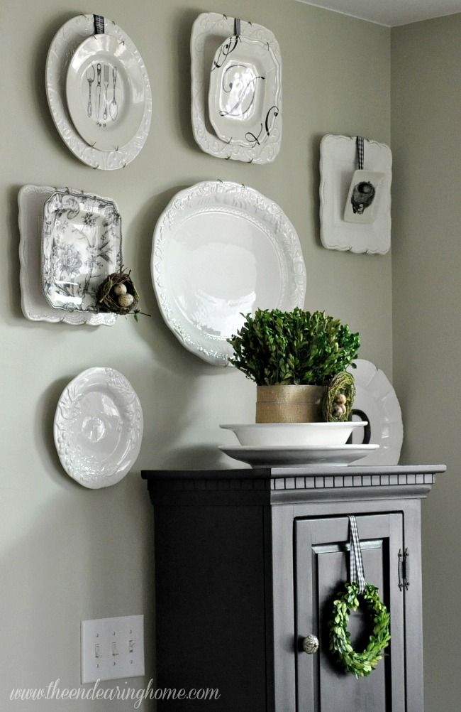 Hanging double plates - Beautiful plate collection.  Love the birds nests. The Endearing Home