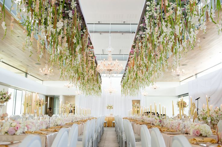 One of our amazing weddings in the Winelands at Cavalli Estate.  Flowers suspended from the roof with a combination of round and rectangular tables with blush pink and gold sequence cloths.  For more, visit our SHOWROOM: www.weddingsbymarius.co.zA.  Co-ordinator: www.weddingsbymarius.co.za Photographer: www.ryangrahamphotography.com Flowers: www.flowersinthefoyer.co.za