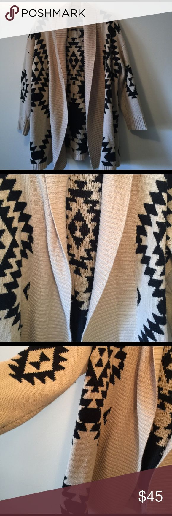 VIP sz L beige/black aztec long cardigan Super cozy and trendy aztec print beige and black long warm cardigan. Size large VIP company. Would look so cute over black leather pants or leggings and even more adorable with some skinny jeans. Wonderful for skiing weather or just a day on the town. Even throw over pajamas. VIP Sweaters Cardigans