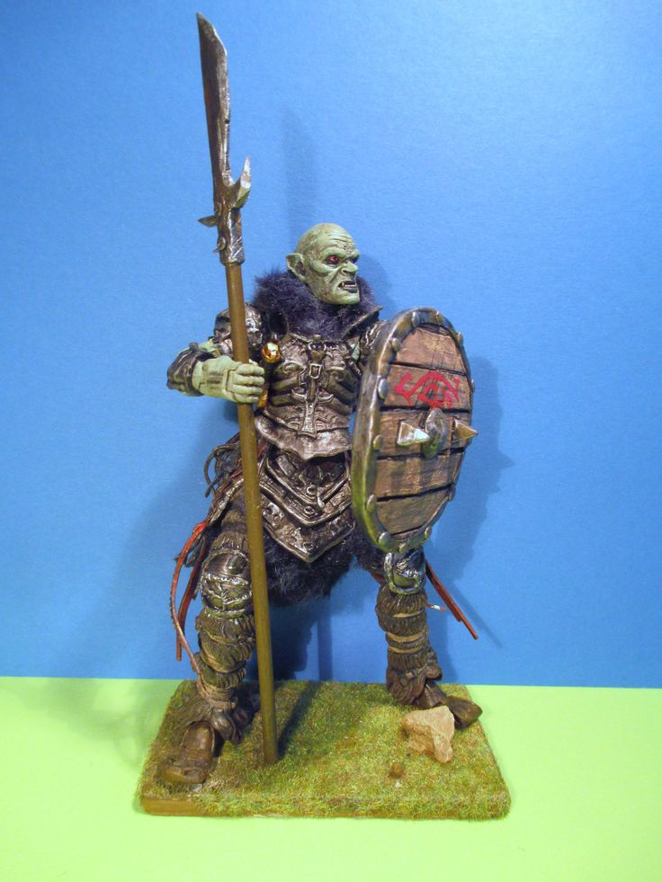 Mordor Orc with handmade weapons, armour and base.  The figure is Gorbag with the overseers head.