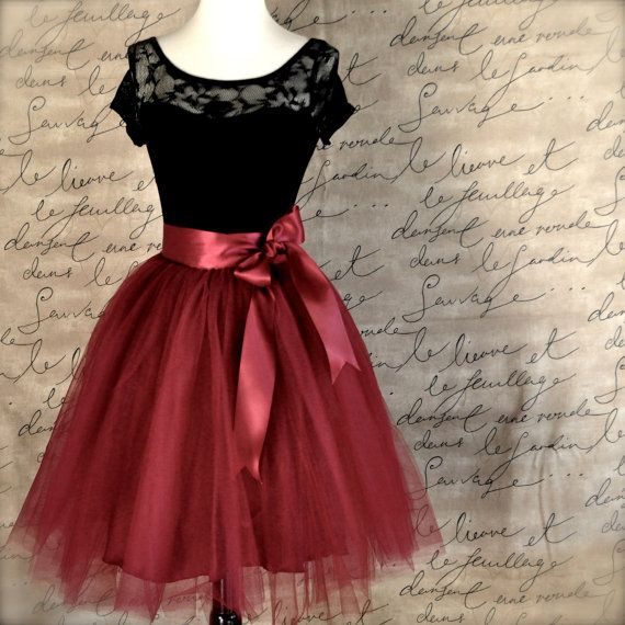 Our womens tulle skirt has layers of burgundy wine tulle over a deep wine satin skirt. You will feel special wearing this classic ballerina skirt. It is a unique garment and you will not find one in a store! The satin skirt serves as a luxe lining and closes with a wide satin ribboned waist and secure hooks. You can tie this wrap tutu top skirt on the side, front or in the back in a bow or overlapped as shown. I have been creating these lovely ballerina skirts since 2009.  --hand-gathered…