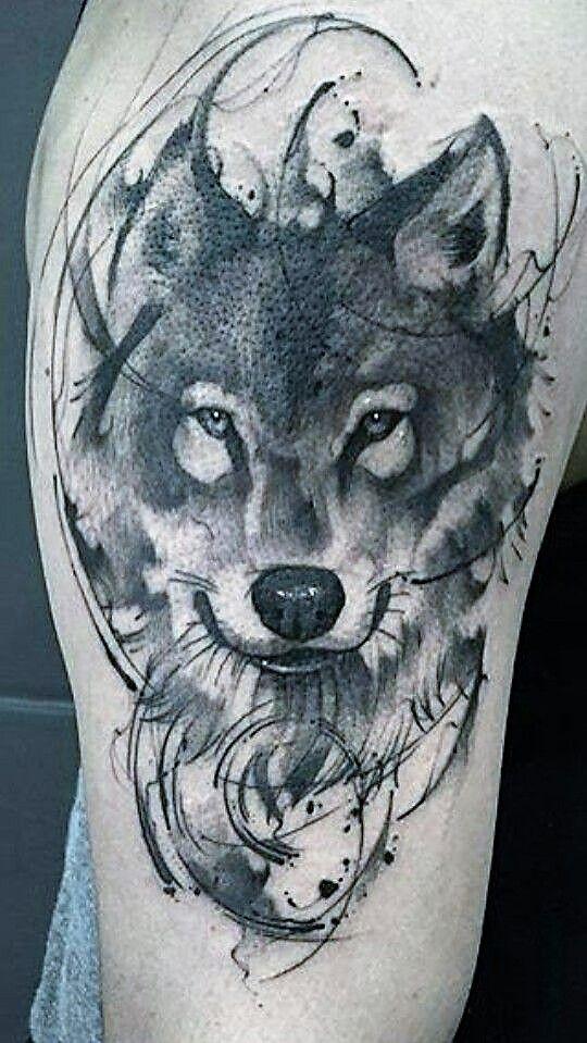 Lovely brush stroke wolf tattoo.