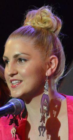 Dorina with metallic earrings