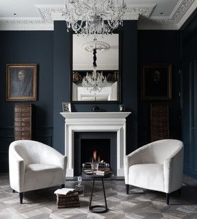 I absolutely love how dramatic this room is! The crisp white is beautiful against the dark charcoal/black (for some reason, it reminds me of Edgar Allen Poe)