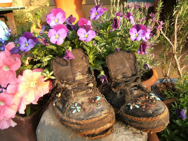 Okay - I did not bead these takkies but when they started to smile... I used them for pots to plant in.