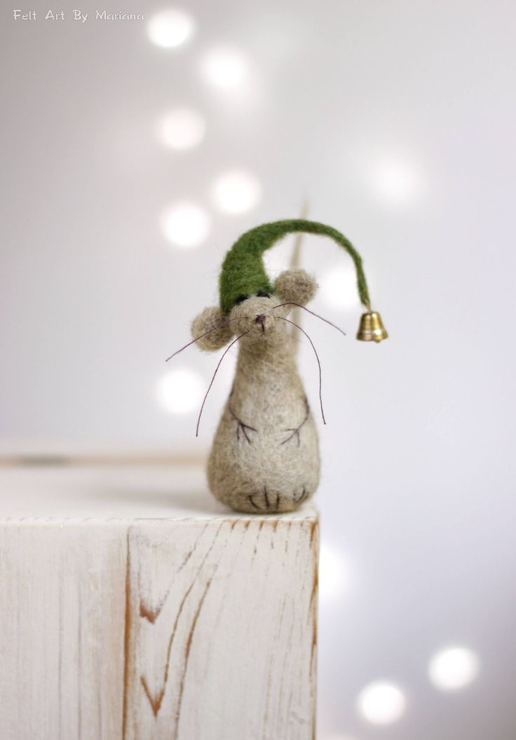 This little needle felted Mouse was born in Sofia a few days ago. He has green hat and while waiting for Santa hes sitting on the fireplace. I use felt needle techniques and 100% pure wool form Bulgaria. I dye the wool by my self to achieve the right colors. Size in centimeters: 7 cm high Size in inches: 2.8 high Each of my dolls are: Created with love. Handmade by me. My own model. Made of 100% sheep wool. I make all my items with love and I hope youll like them. If you have questions ...