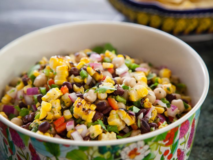 Grilled Corn and Bean Salad : Combine corn, beans and fresh veggies for this colorful salad. Pack the flavor in with Valerie's spicy and tangy dressing featuring lime juice and hot sauce.