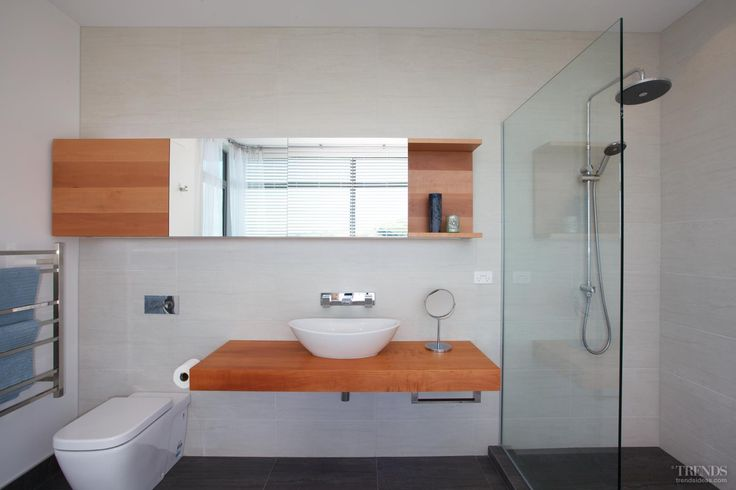 Most design elements are simple and unadorned, and reflect a connection to nature, such as the minimalist vanity and slate floor in the bathroom. Low-flow water fixtures were specified.