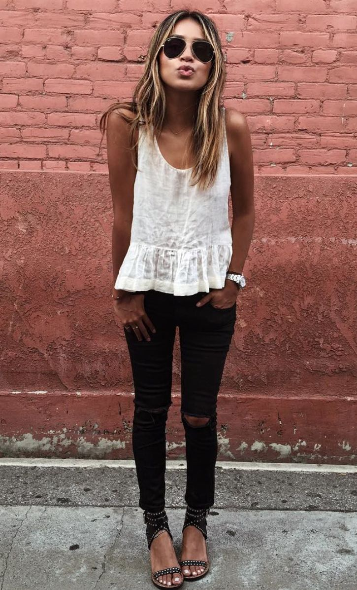 lace top and black ripped skinny jeans