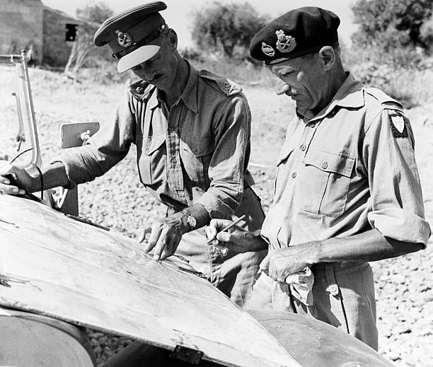Lieutenant General Miles Dempsey (left) and Field Marshal Bernard Montgomery of the British Army reviewing a map of the work of the Royal Engineers in Sicily during World War Two on 9th August 1943. Pin by Paolo Marzioli