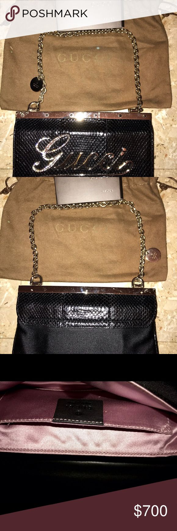 Gucci purse (black) Authentic Gucci purse. Python skin snd Swarovski crystals. Very good condition a few scratches on the gold hardware. Python skin in perfect condition Gucci Bags Clutches & Wristlets