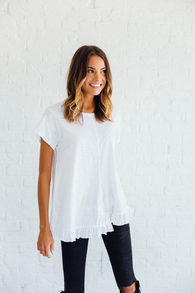 DETAILS: Loose fit, short sleeve, round neck, asymmetrical ruffle edge detail. 50% Modal, 50% Cotton MADE IN THE USA Model...
