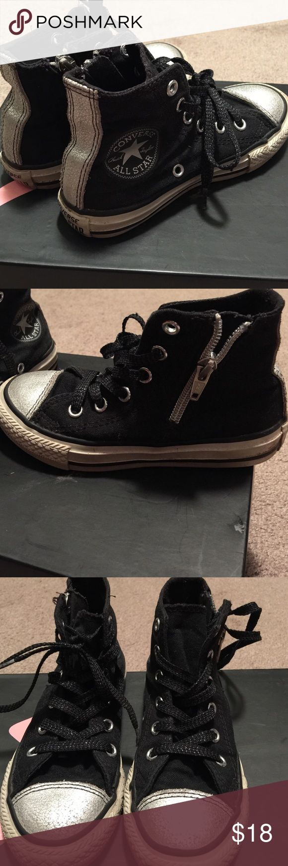 Little girls high top converse size 11 shoe Black an silver girls high top converse size 11 with a zipper on the side. Converse Shoes Sneakers