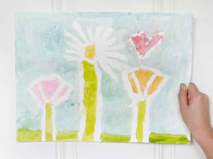 Kids can create a beautiful work of art using Painters tape and watercolor. Simple, relatively mess-free and this Spring Watercolor Art Lesson is the perfect afternoon activity for Spring/Summer!