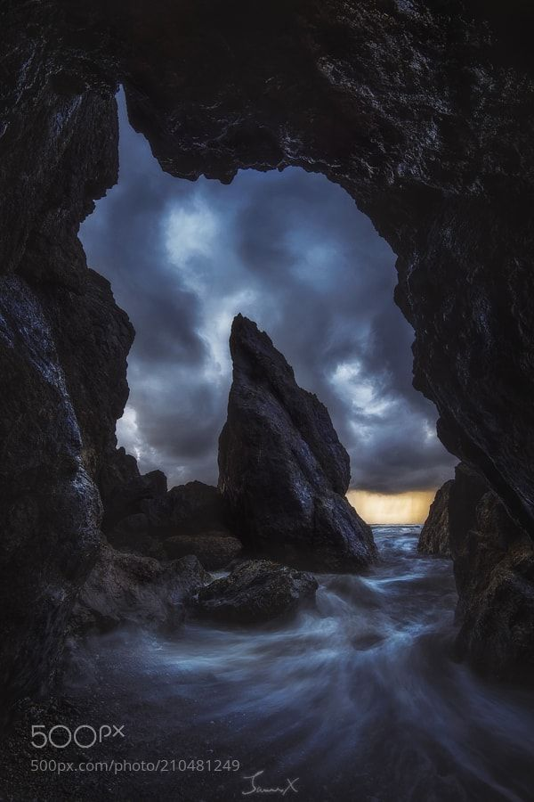 Dream Cave - This is my first time being to the Olympic National Park in Washington. The weather along the coast changed so rapidly. It could switch between sunshine to pouring rain within minutes. By the time I got to this beach I knew for certain that the weather was not going to get any better and a rain was on the way. Luckily the stormy clouds seemed to be very dramatic from inside this cave and I was so happy that I could make this photo work. When I look at photo it reminds me of a…