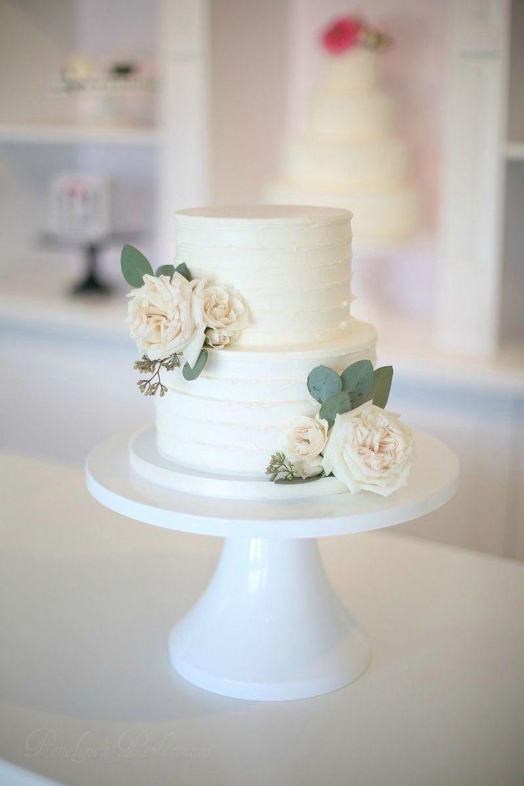 Blush garden roses and eucalyptus leaves buttercream cake