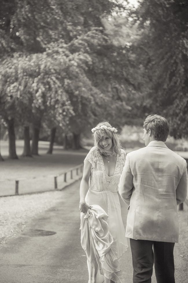 Kelly Reilly and Kyle Baugher walking down a tree lined ...