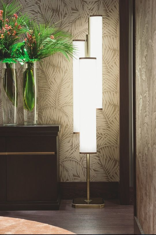 Detail of the Autumn Leaves room by Oasis, with Moritz cupboard and Flower floor lamp. The wall so decorated with wallpaper inspired to the Coromandel screens.