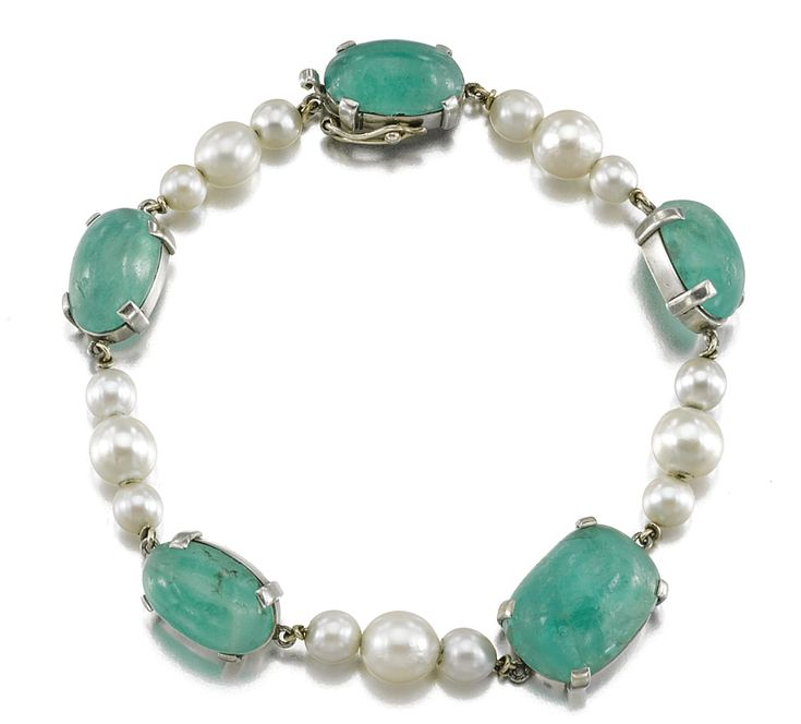 An emerald and pearl bracelet.