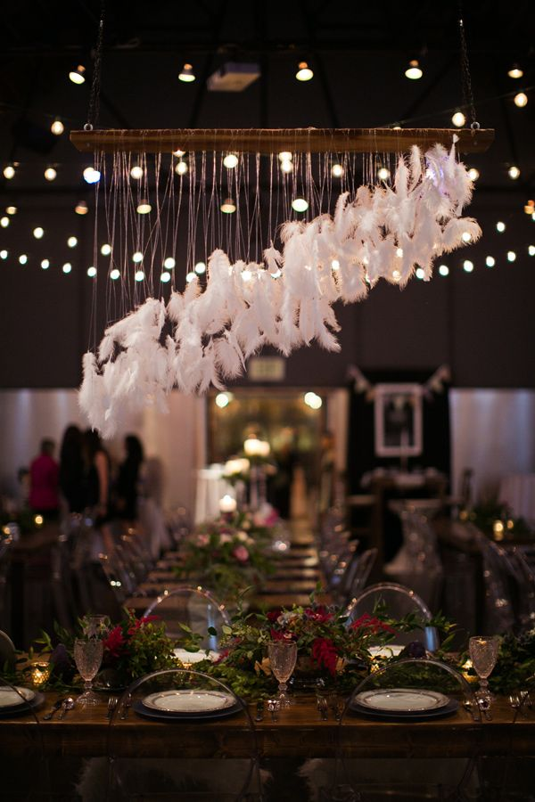 "feather ""chandelier"", photo by Our Ampersand Photography http://ruffledblog.com/elegant-grey-and-purple-wedding-inspiration #weddingideas #feathers"