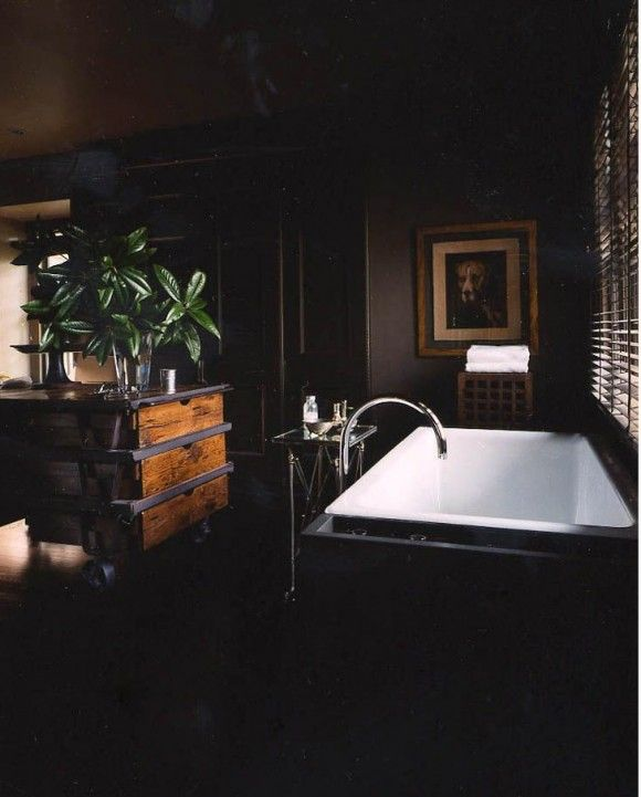 The dark drama of this bathroom plus the mix of elements--those wood and steel industrial drawers are amazing--is all very appealing.