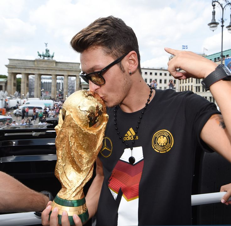 Germany Victory Celebration Mesut Oezil celebrates on the open top bus at the German team victory ceremony July 15, 2014 in Berlin, Germany. Germany won the 2014 FIFA World Cup Brazil match against Argentina in Rio de Janeiro on July 13.