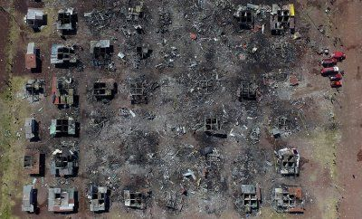 Disasters in 2016: Photos of devastation wrought by earthquakes, floods, fires and hurricanes:       Aerial view of Mexico's biggest fireworks market in Tultepec suburb, Mexico State, after a massive explosion killed at least 32 people, on 21 December 2016  Mario Vazquez/AFP
