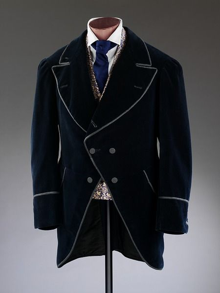 This early 1870s morning coat was known as the 'University' style. It is characterised by sharply angled cut-away fronts, short length and double-breasted style. The wide collar and lapels are typical of the 1870s, as is the loose sleeve.