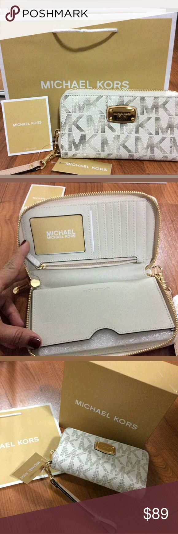 Michael kors $145 wallet AUTHENTIC id card phone New with tag and shopping bag Michael Kors Bags Wallets