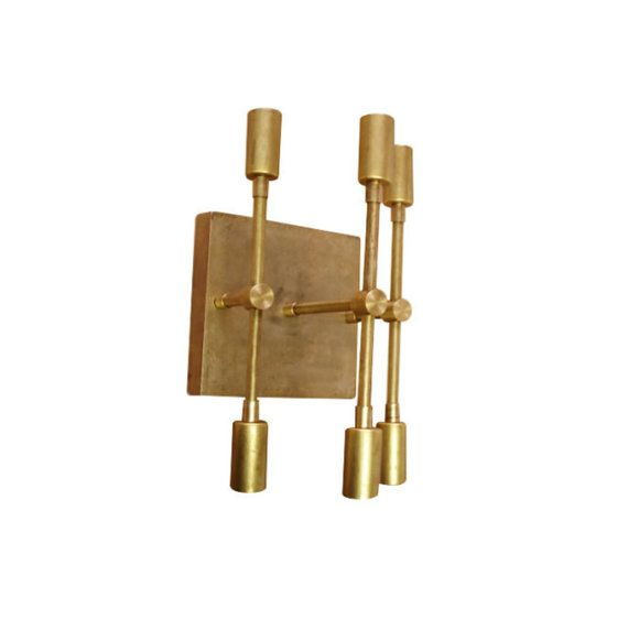 Mid-Century Modern Raw Brass 6 Light Sconce. I want to see this with globes!