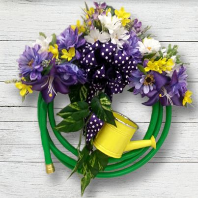 The Garden Hose Wreath, created at our Mechanicsburg, PA store, is perfect for spring! #sprng #wreath #gardenhose #DIY #craft