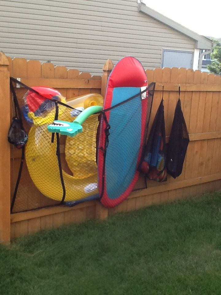Beautiful Cheap Way To Store Pool Toys. Truck Cargo Net And Some Laundry Bags. Itu0027s