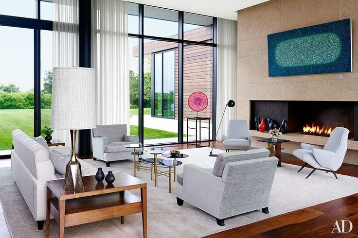 A Richard Pousette-Dart painting surveys the living room of a Bridgehampton, New York, residence created by the architecture, interiors, and landscape firm Sawyer Berson and furnished by LRS Designs   archdigest.com