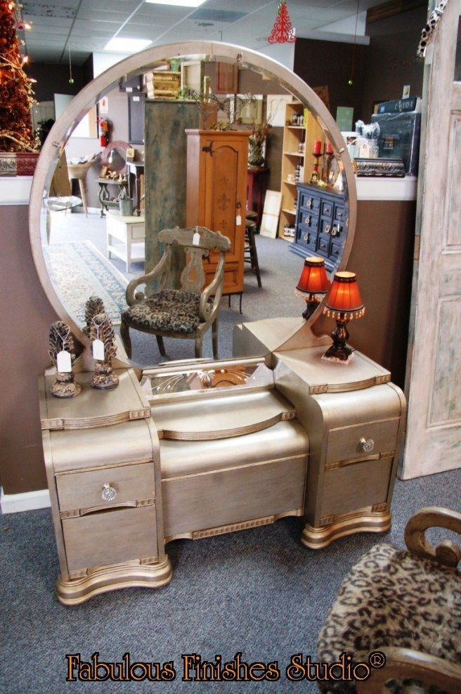 A vintage waterfall vanity that I refinished with a metallic silver finish.