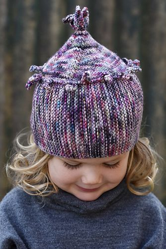 Chesser is a playful Hat featuring a sideways knit brim+body and a vertically knit crown.