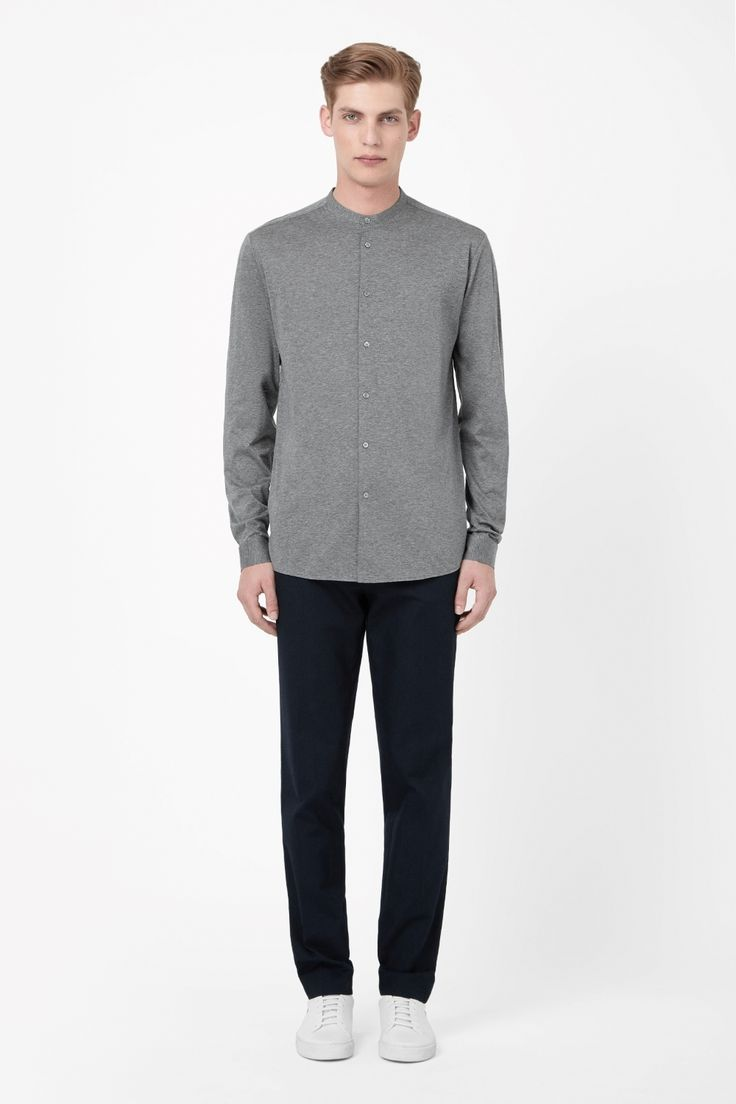A collarless style, this shirt is made from extra-soft cotton jersey with a subtle melange quality. Worn on its own or as an extra layer, it is a regular fit with a subtle curved hem and pearlescent button fastening.