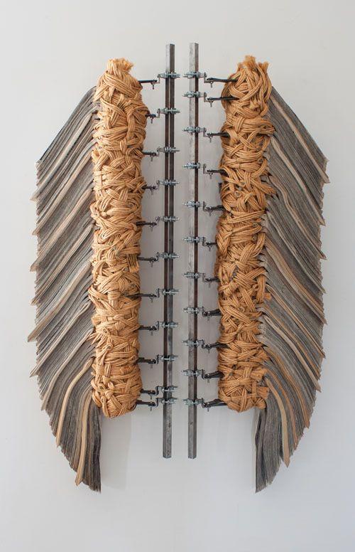 Katie Hunt, newspaper, encaustic, metal clamp, baling twine, 54x32x6   /Artist-Detail.cfm?ArtistsID=778
