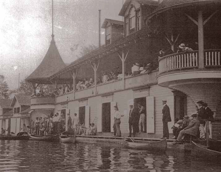 In the late 1800s and early 1900s, the banks of the Rideau Canal in downtown Ottawa were dotted with wooden boathouses. Among them, at the point that Queen Elizabeth Driveway and Fifth Avenue meet, was an impressive three-storey, turreted frame building — the boathouse owned by the Rideau Aquatic Club. This was the original name of the Rideau Canoe Club. The foundations of the now-defunct marina are still visible at low water.