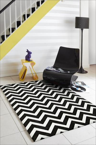 A chevron patterned rug is a classic, timeless design. Imagine this one in your home: Calais Black White Zig Zag Chevron Patterned Modern Rug