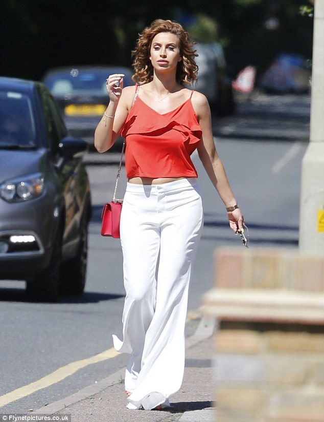 Radiant: Ferne McCann, 26, looked absolutely radiant as she flaunted her ever-growing stomach in a thigh-grazing orange cami top