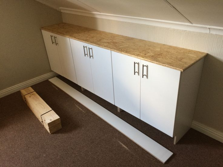 Loft storage cupboards with an OSB counter top.