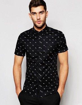 Camisa entallada de manga corta en negro con estampado de florecitas fluorescentes de ASOS