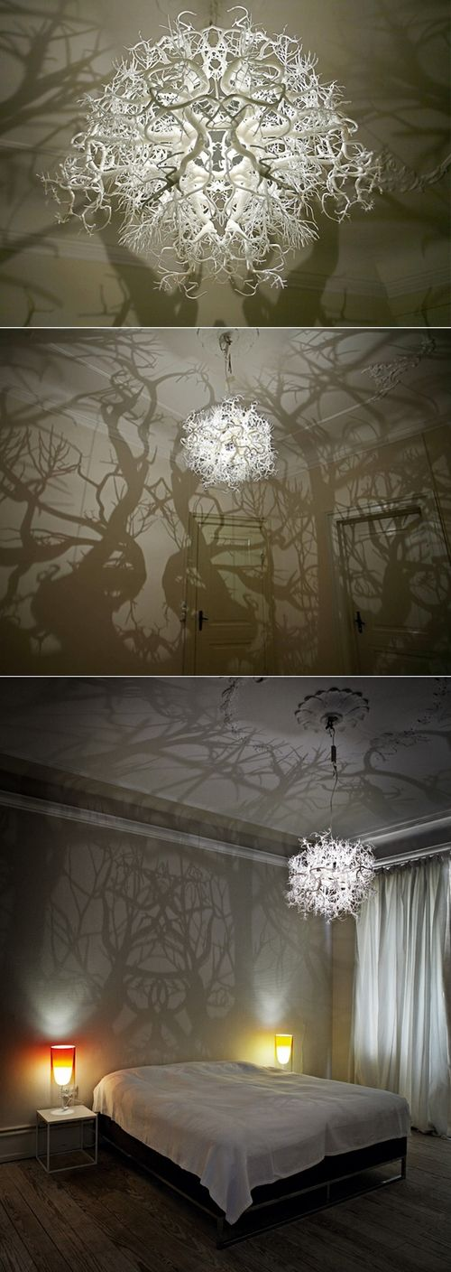 Forms in Nature Light Sculpture  That chandelier is reminiscent of a ball of tree branches. The piece incorporates a light source at the center, which illuminates the tree and root system and casts a forest of wild trees onto the floor, walls, and ceiling of a room. The intensity of the light changes the setting of the room, moving from strong, dark shadows, to soft, flickering shadows as the light dims. By artists, Thyra Hilden & Pio Diaz.