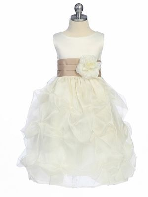 champagne sash and flower on the flower girls dress
