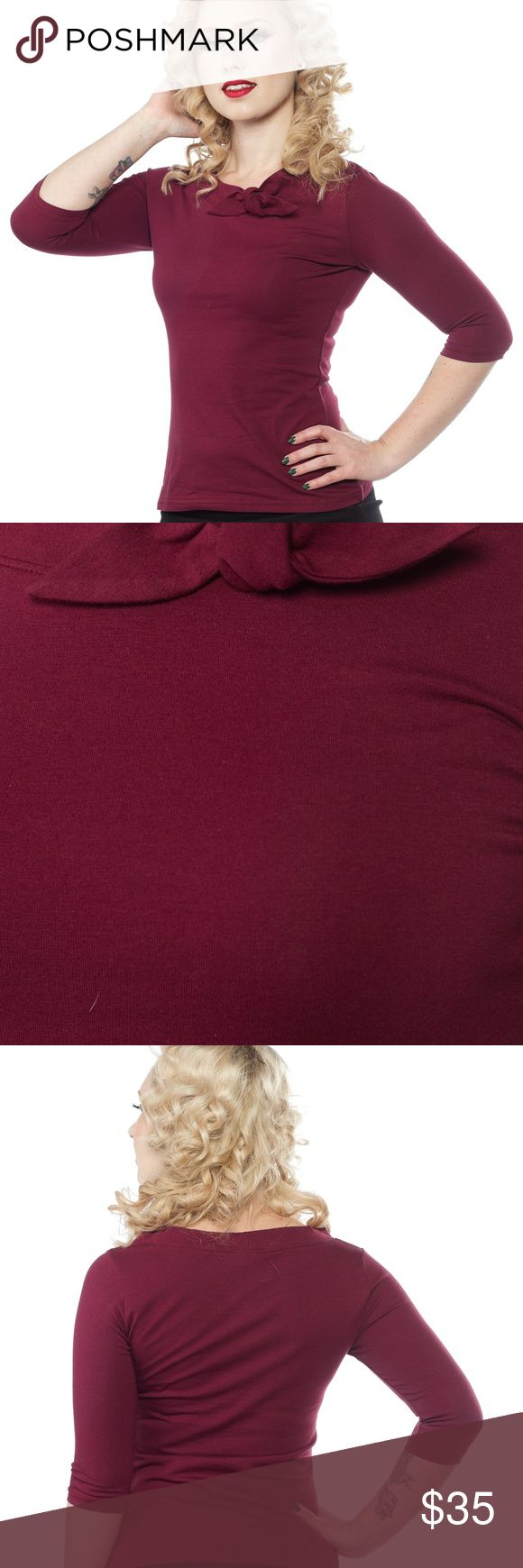 """Heart of Haute Burgundy Top Rockabilly PinUp 1X This is BRAND NEW! By Heart of Haute (Their Mandi Bee line) in a size 1X.  DETAILS:  This adorable, versatile top is necessary in every gal's wardrobe. It's a lovely burgundy color and has 3/4 sleeves with a square knot collar. It's the perfect piece to match with any skirt for a vintage pinup look. Made in the USA ADDITIONAL INFORMATION:  97% Cotton / 3% Lycra Machine wash cold Tumble dry low  Bust:42-50 Waist:38-46 Hips:44-54 Length:24"""" Heart…"""