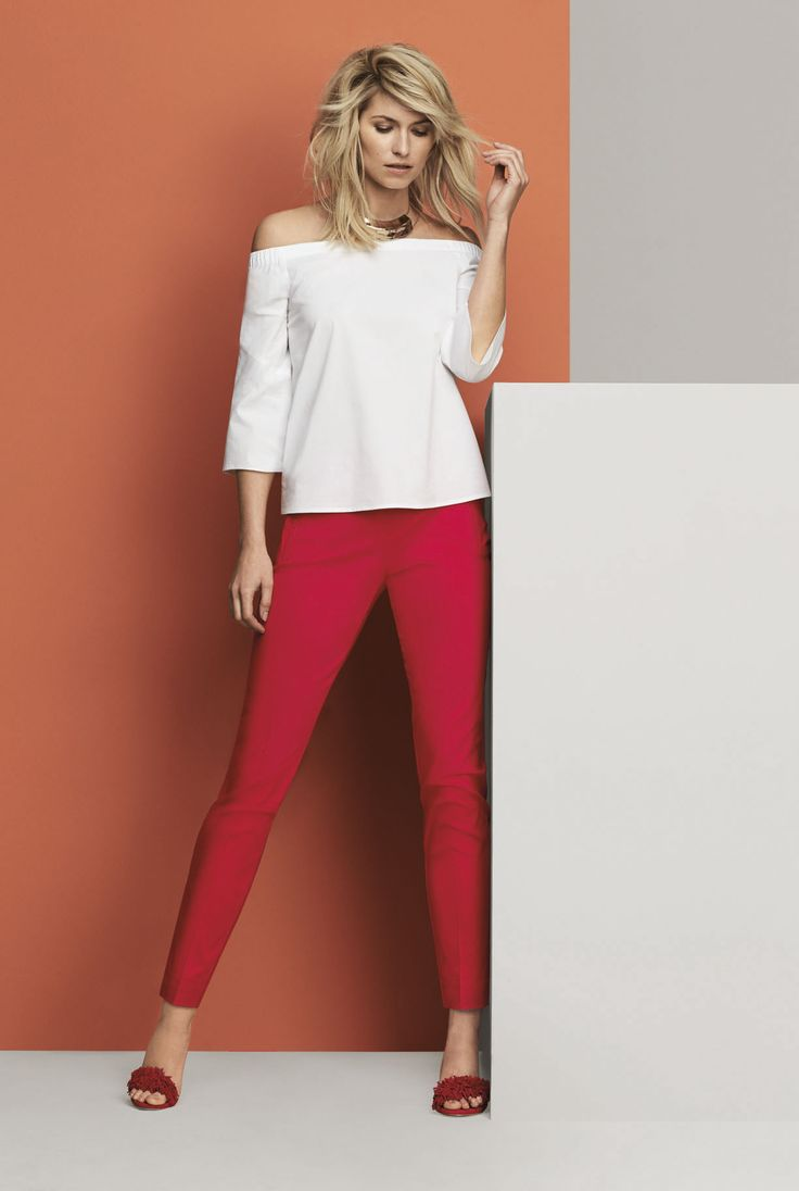 Crisp poplin in an off-shoulder style is trending though to fall and it has never looked better than paired with cherry-red bottoms.