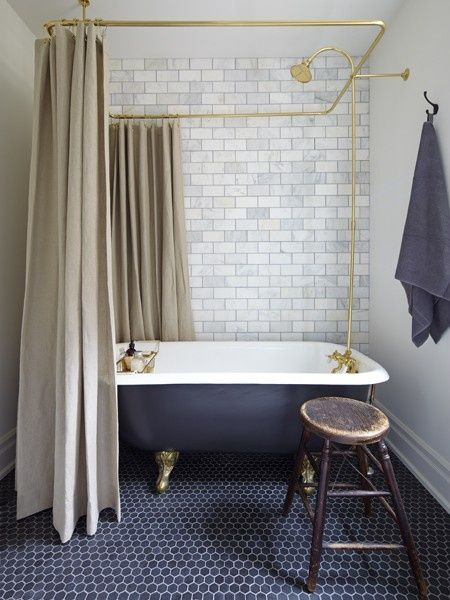Vintage bathroom with subway tiles, brass and shower curtains