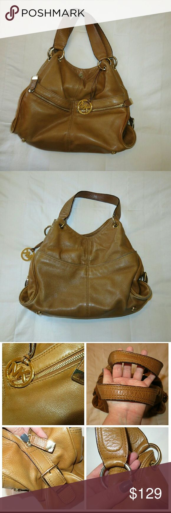 Leather Michael Kors bag Price is firm. Still thinking about holding on to bag. It goes with everything and with all seasons.  Gorgeous and timeless MK leather bag with gold hardware. Tons of organized storage on inside and outside with Convenient Pockets and zippers on outer front and back. Detachable strap.  Good condition. Has hardware scratches and stains on interior but nothing noticeable. Stitching and overall condition of bag is good.  I Have used leather cleaner and moisturizer to…